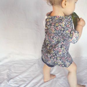 A free layout and tutorial for sewing a simple tie back blouse for a toddler.