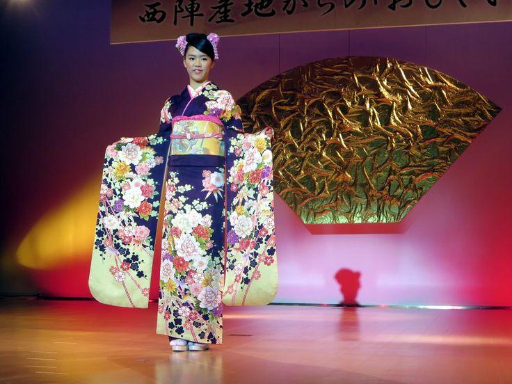 A model shows off a silk kimono at the Nihijin Textile Center in Kyoto, Japan.