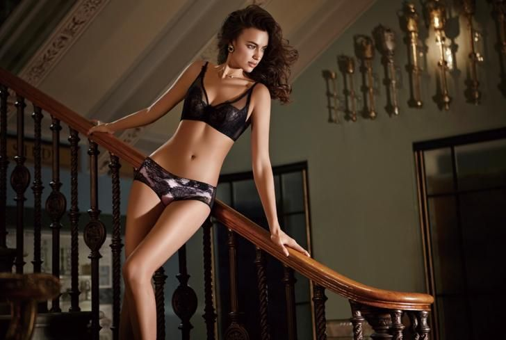 Irina Shayk doesn't need a fancy ball gown to look glamorous! The 29-year-old babe showed off her natural beauty in a set of sexy black lingerie as she posed on a staircase for the steamy shoot.