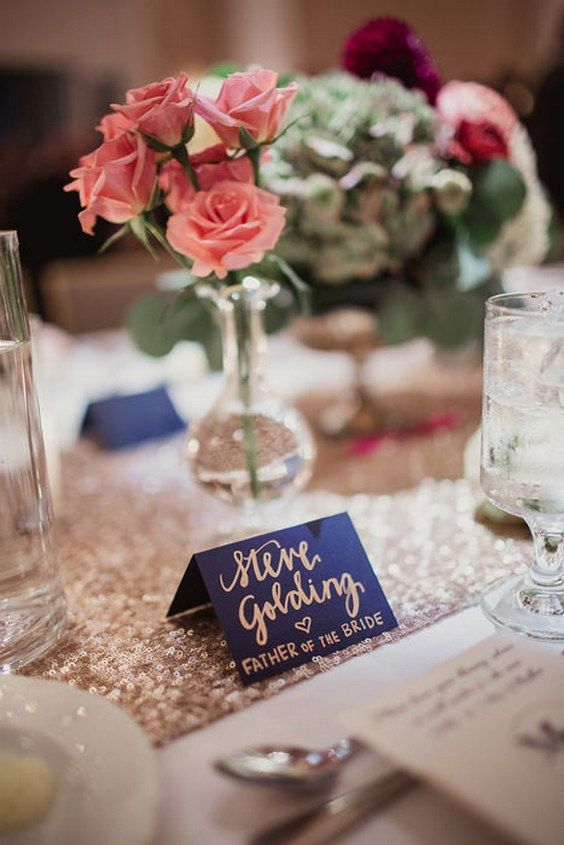 navy place cards wedding centerpiece / http://www.deerpearlflowers.com/navy-blue-and-gold-wedding-color-ideas/