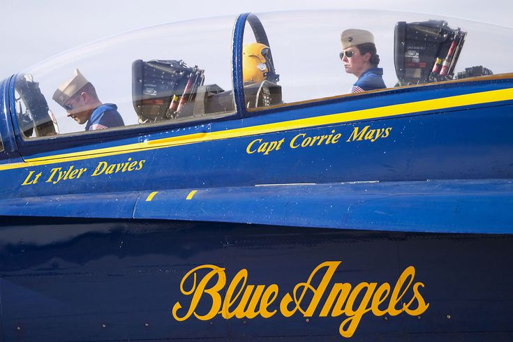 Blue Angels-Lieutenant Tyler Davis, left, and Captain Corrie Mays, right, land the Blue Angels plane at the United States Coast Guard Air Station in Traverse City for a meeting about National Cherry Festival 2016.