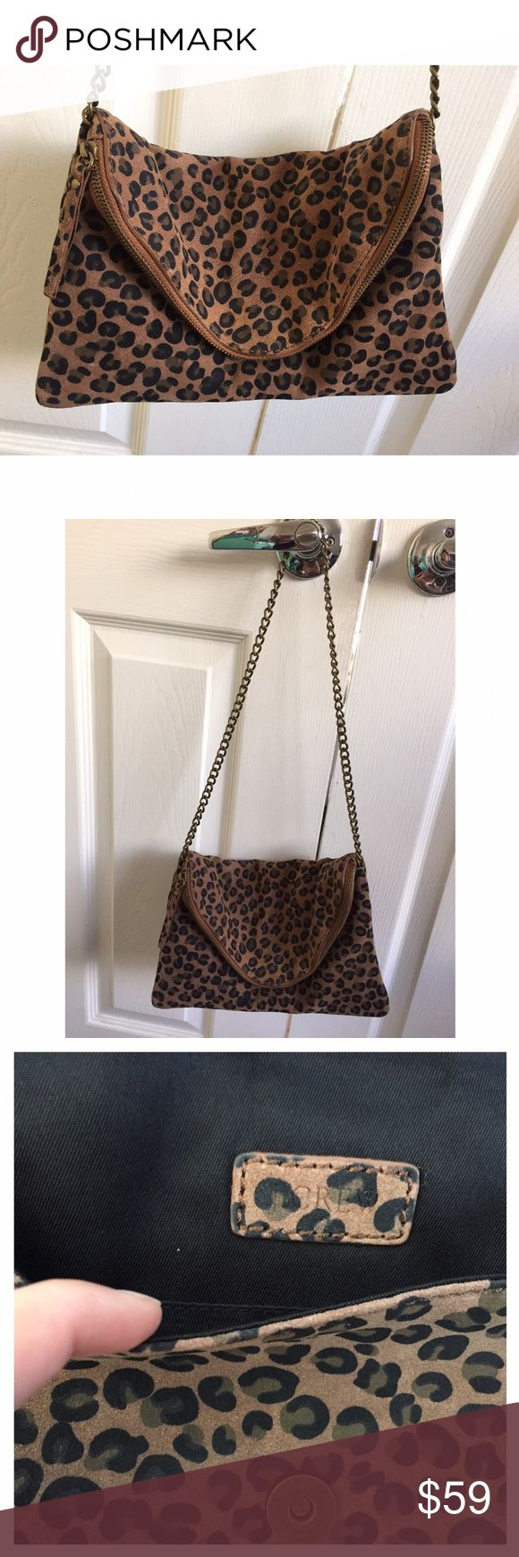 J. Crew Animal Print Bag Animal print wristlet/clutch. Magnetic button closure at front + zip closure. Large pocket on the backside. Worn just twice. Like new. J. Crew Bags Mini Bags