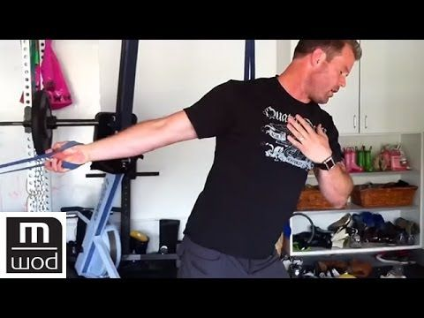 When we're sitting, we're normally hunched forward in a rounded position. This limits our ability to get our arms over head whether that's reaching up into a cabinet or pressing a weight. Using a band to aid the stretch, Kelly Starrett attacks the shoulder joint from five different directions to increase mobility.