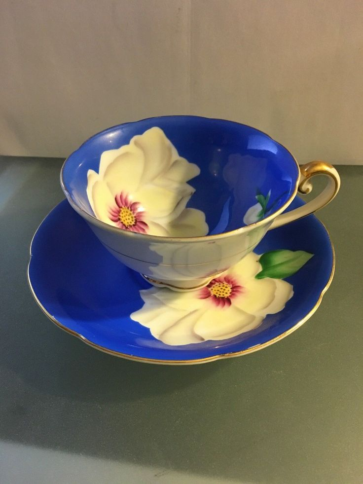 MERITCHINA Tea Cup & Saucer Gold Trim / Lily Hand Painted Made in Japan - CAD $16.30. You are looking at a beautiful tea cup and saucer combo from MeritChina. This particular set has blue tone and white flowers. Upon observation I noticed a small indent on the bottom of the saucer. This comes from a grandmother's china collection. I will ship the piece wrapped carefully. This would be a fantastic holiday gift. 263435048943