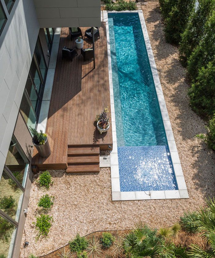 Narrow And Long Pool In A Yard Covered With Beige Pebbles Green Shrubs And Other Plants Small Backyard Design Small Backyard Landscaping Small Backyard Pools