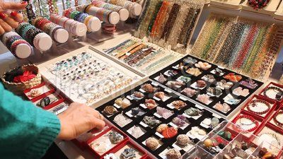 Woman looking gemstones of different colors and shape.