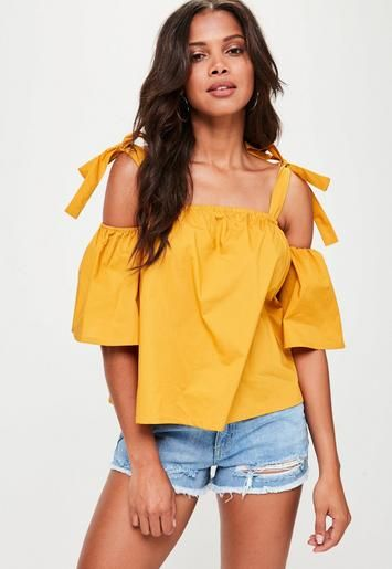 Yellow crop top with a supported bardot style, elasticated neckline, short sleeves and tie shoulders.