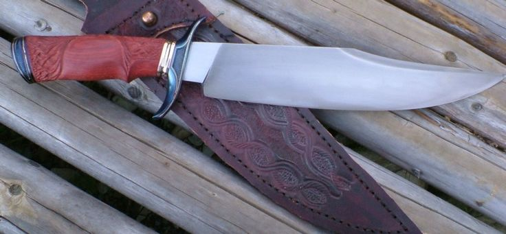 Carved Bloodwood Fighter.Forged 1075 blade with temperline.Fire blued steel fittings with silver inlay.Spacers of bronze and nickel silver.Carved bloodwood handle.