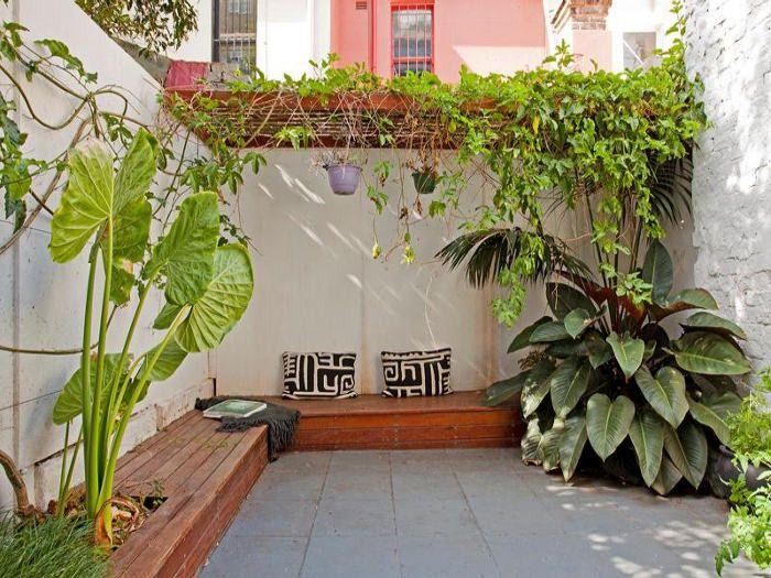 Las 25 mejores ideas sobre patio trasero peque o en for Pisos para patios pequenos
