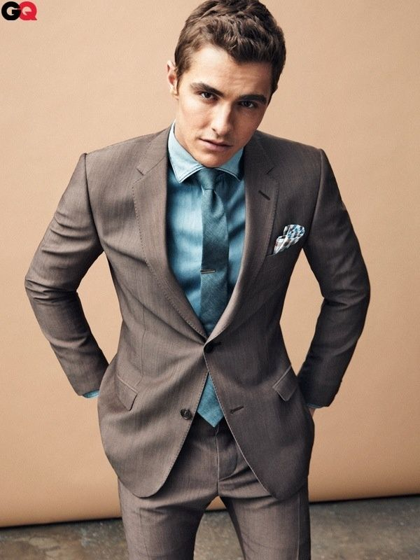Shop Dave Franco's look for $503:  http://lookastic.com/men/looks/pocket-square-and-tie-and-dress-shirt-and-blazer-and-dress-pants/1431  — White and Blue Gingham Cotton Pocket Square  — Teal Silk Tie  — Light Blue Silk Dress Shirt  — Brown Blazer  — Brown Dress Pants
