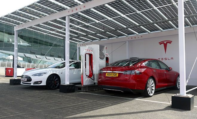 Tesla Model S At Solar Charging Station Uses Of Solar Energy Solar Panel Cost Solar Charging Station