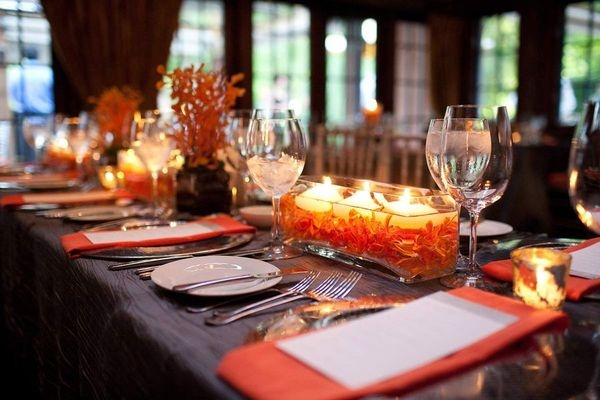 Orange, brown and candles tablescape