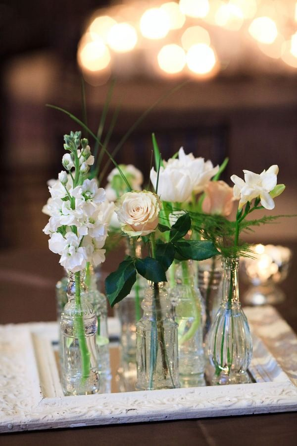 i like the center pieces with simple mismatched glasses and pretty white flowers. need more hydrangeas.