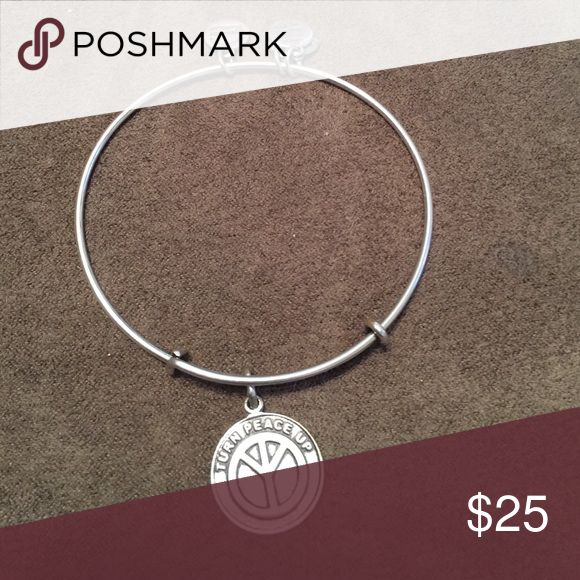 Turn Peace Up Bangle Silver Bangle. Turn Peace Up phrase with upside down peace sign. ☮️ Gently used but in great condition. Alex & Ani Jewelry Bracelets