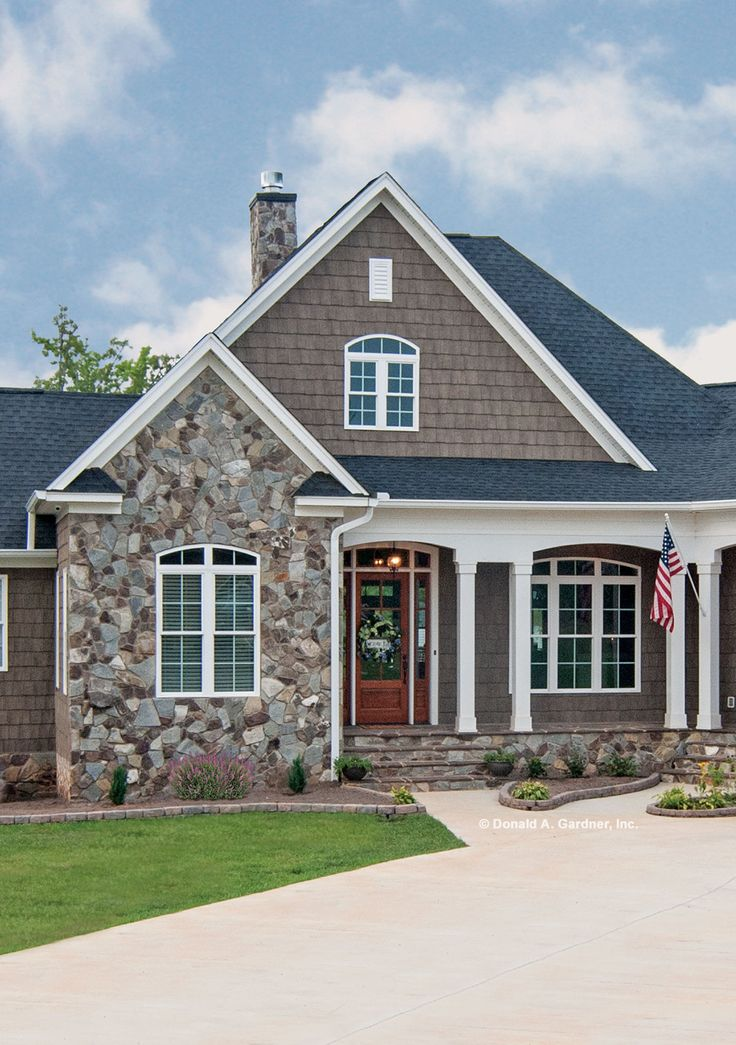 This front porch is framed with columns and stone http for House plans with columns and porches