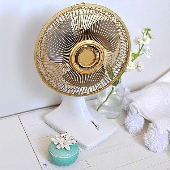 Turn a blah fan into eye-catching decor with gold paint.