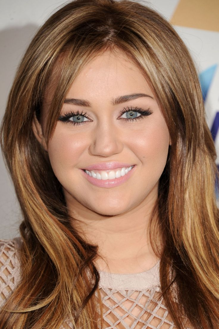 Miley Cyrus at the 2011 Grammy Salute to Icons event.