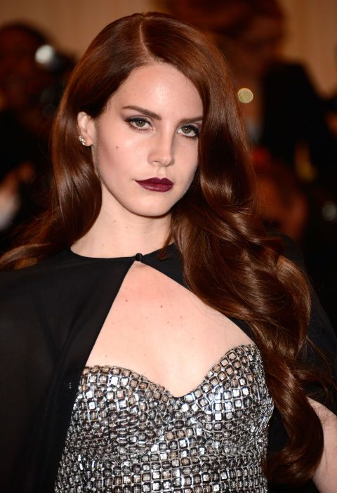 Lana's moody hair proves that auburn can be hella edgy. (The cape doesn't hurt either.)