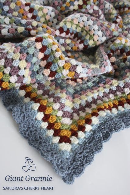 Lovely Giant Granny Square blanket by Cherry Heart - Border Pattern:  No. 45 from Around the Corner Crochet Borders by Edie Eckman