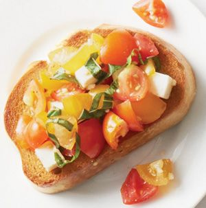 Classic flavors are always the way to go. Mozzarella, Tomato and Basil on Italian Bread crostini will probably fly off the platter at your party. They're also a great side dish for a light lunch of grilled chicken and fruit salad.