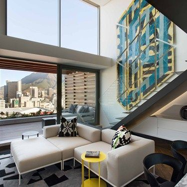 FutureSpaces - De Waterkant Apartment. the interior is a stylised and dynamic clutter free space that is a forward thinking, contemporary luxury urban space that maximises spatial use, cutting edge design and technology.