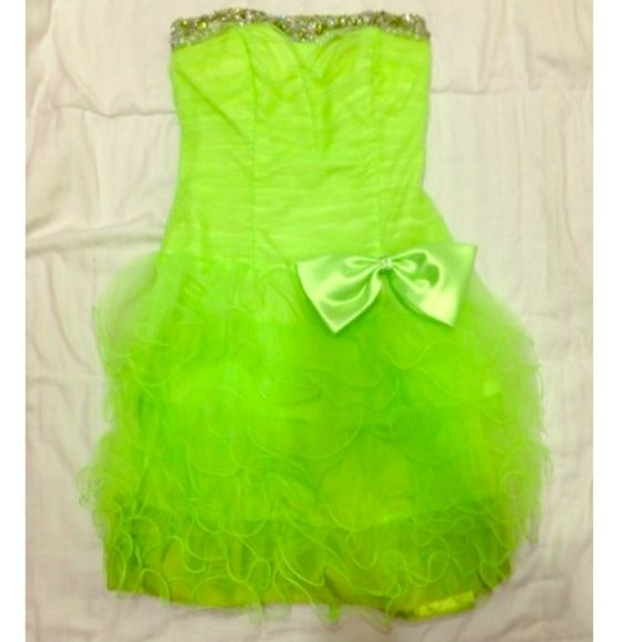 Lime green prom dress Lime green formal dress with bow. Size small. Has a corset back and a zipper. Never been worn. Dresses Prom
