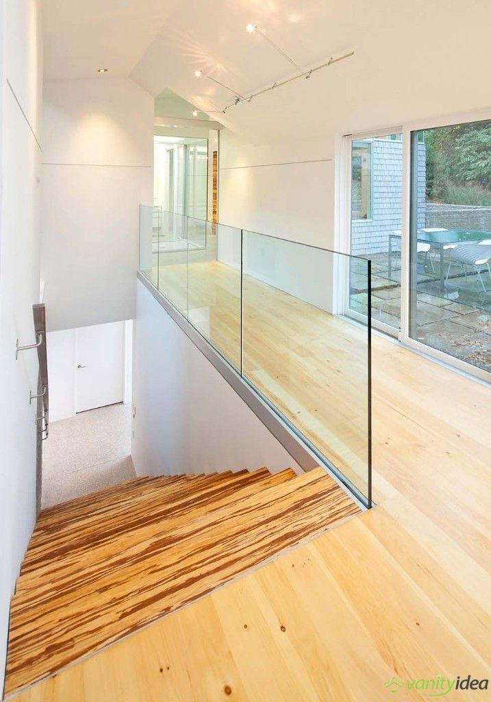 wooden stairs, white walls and big windows design