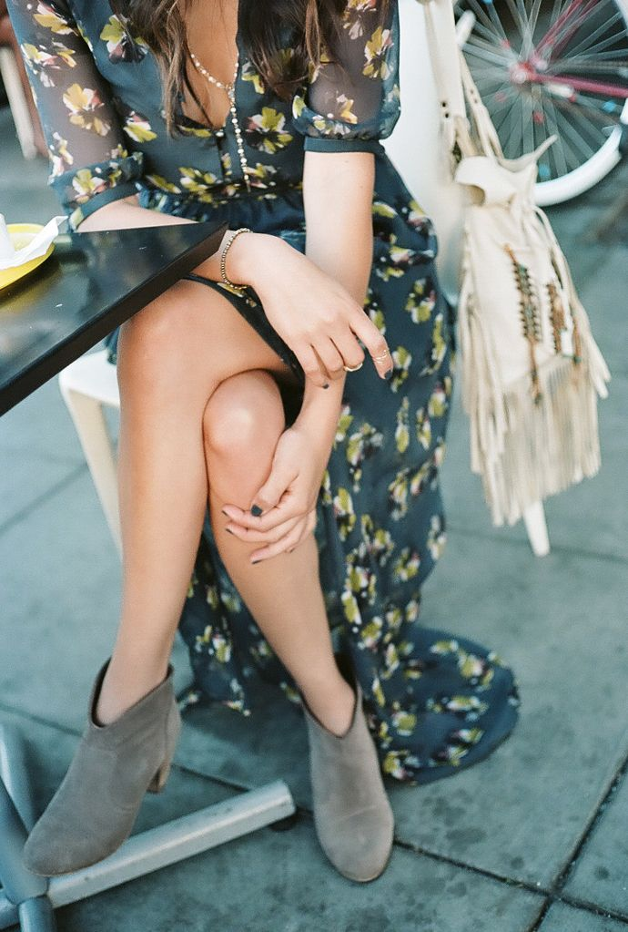 Dress down a floral maxi for fall with suede ankle booties.