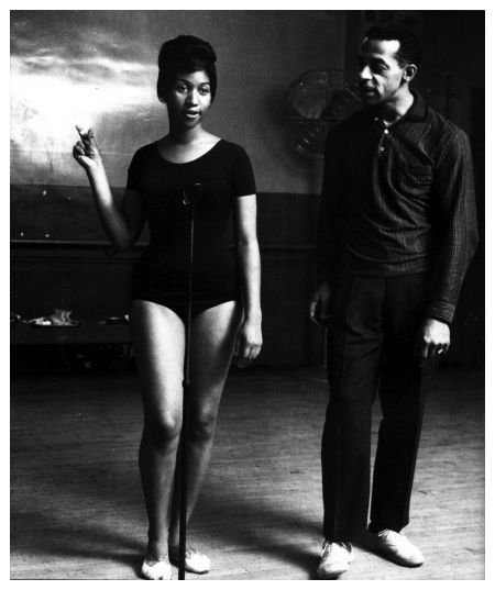 1961: 19-year-old Aretha working with Motown choreographer Cholly Atkins. Franklin was still singing pop ballads, under contract to Columbia Records. It was several years later that she moved to Atlantic Records and created the megahits that came to define soul music. (Frank Driggs Collection)