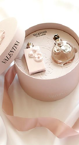 This is a very feminine style of packaging for these two bottles of perfume. The…