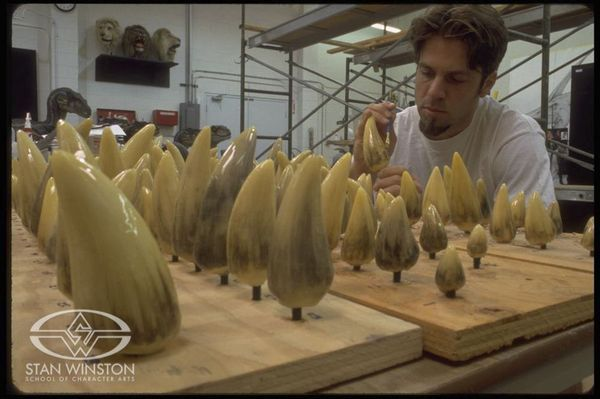 Special Effects Character Creator Rob Ramsdell applies paint washes to the multitudes of dinosaur teeth belonging to JURASSIC PARK III's Spinosaurus.