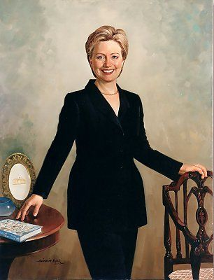 There were a number of firsts with the painting of Hillary Clinton's portrait. The first African American portrait artist Simmie Knox did a tandem of her and President's Clinton's official oil portraits. She is wearing a pantsuit with her hand touching her best selling book with an example of historic White House China on the table. The painting hangs on the Ground floor in the Hall. Portraits courtesy of the White House Collection.