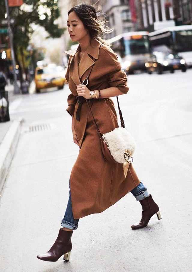 On Aimee Song: Zara coat; Paige Sequin Star Patch High Rise Straight Leg Jeans (Jupiter Embellished)($339); Diane von FurstenbergShearling Love Power Saddle Bag ($238); Celine boots.
