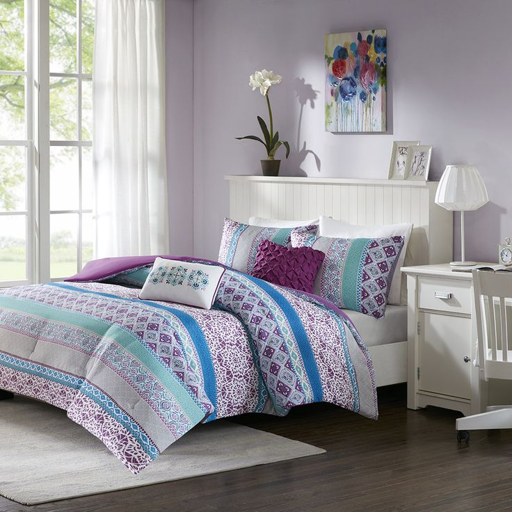 Give your bedroom a bohemian update with the Intelligent Design Joni 5 Piece Comforter Set. Featuring gorgeous hues of purple, blue, turquoise and grey, this color combination enhances the intricacies of the global inspired pattern showcased throughout the Full/Queen sized comforter. A decorative pillow with embroidered medallions adds the finishing touch and brings the whole look together.