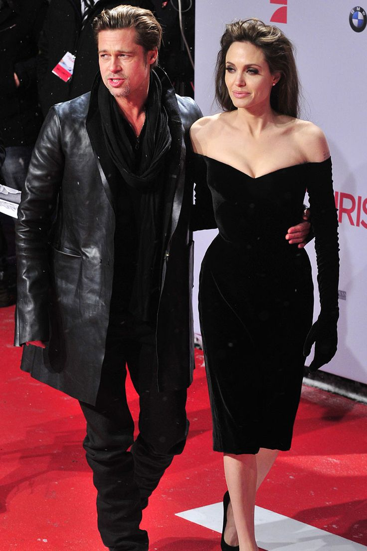 She steps out in an off-the-shoulder, velvet Versace black dress at the Berlin premiere of The Tourist. The dress' built-in gloves not only keep her warm, but also fashion-forward. www.bridalgloves.com