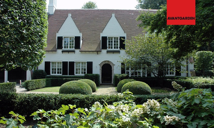 Dutch Colonial With White Painted Brick Gardens