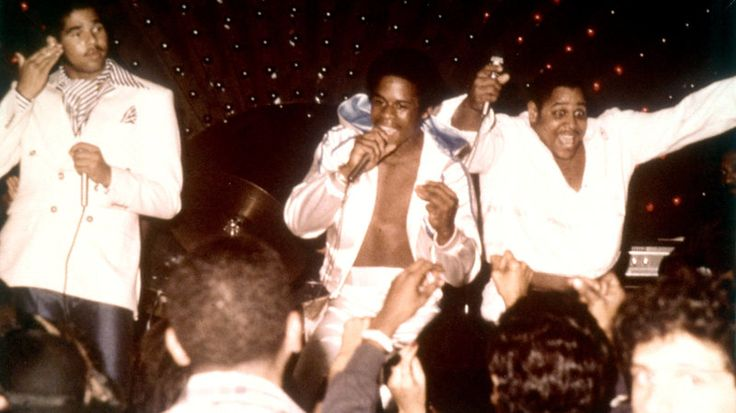 Rap pioneers the Sugarhill Gang (left to right: Wonder Mike, Master G and Big Bank Hank) perform live circa 1979.