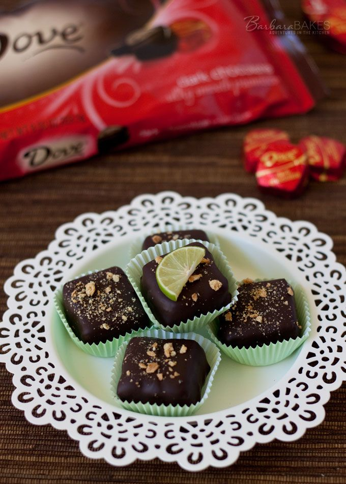 Irresistible Key Lime Cheesecake Bites covered in Dove Dark Chocolate from Barbara Bakes.