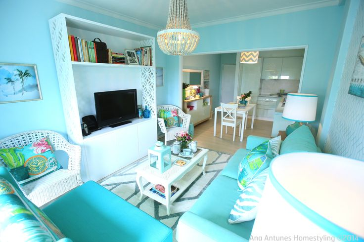coastal inspired, beach house, seaside inspired, turquoise blue, aqua blue, turquoise sofa, aqua blue kitchen, small open plan living room, small spaces, canovas fabric, tropical pillows, geometric rug, geometric wallpaper