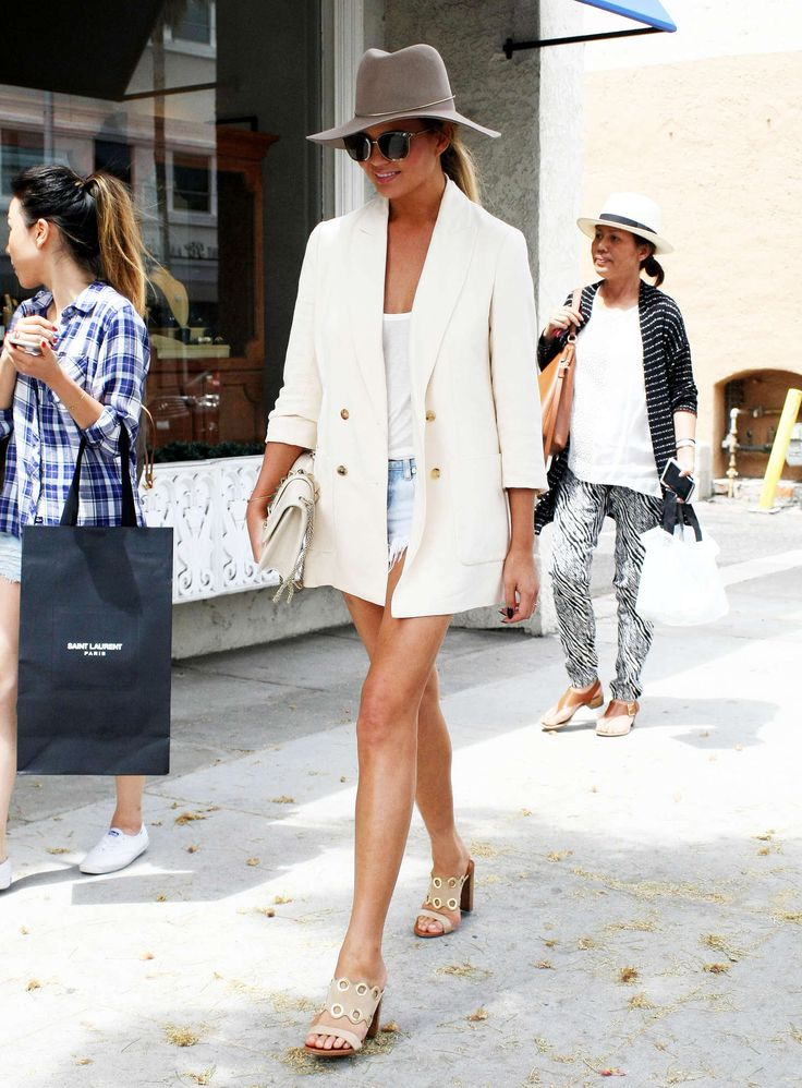 Chrissy Teigen.. Janessa Leone hat, The Row jacket, One Teaspoon shorts, and Valentino purse..