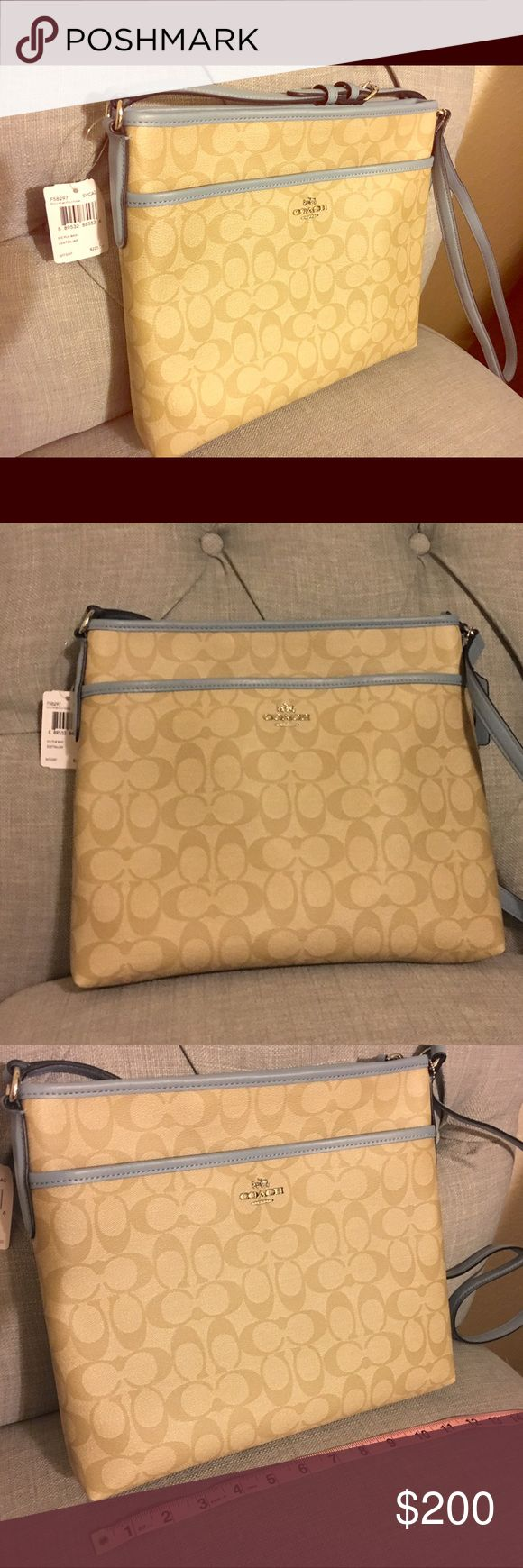 Coach blue tan cross body NWT Coach blue tan crossbody travel bag perfect for iPad, airline tickets and passport. NWT never used. Will be immaculately shipped. Coach Bags Crossbody Bags