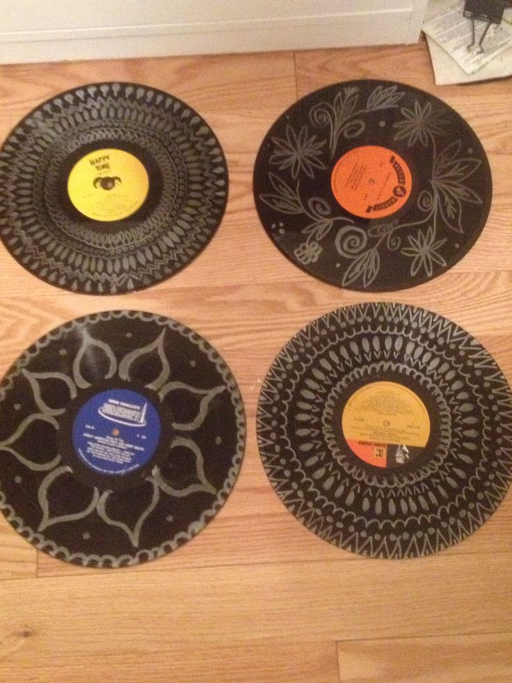 Metallic sharpie on old records as wall decoration, still need to hang them.