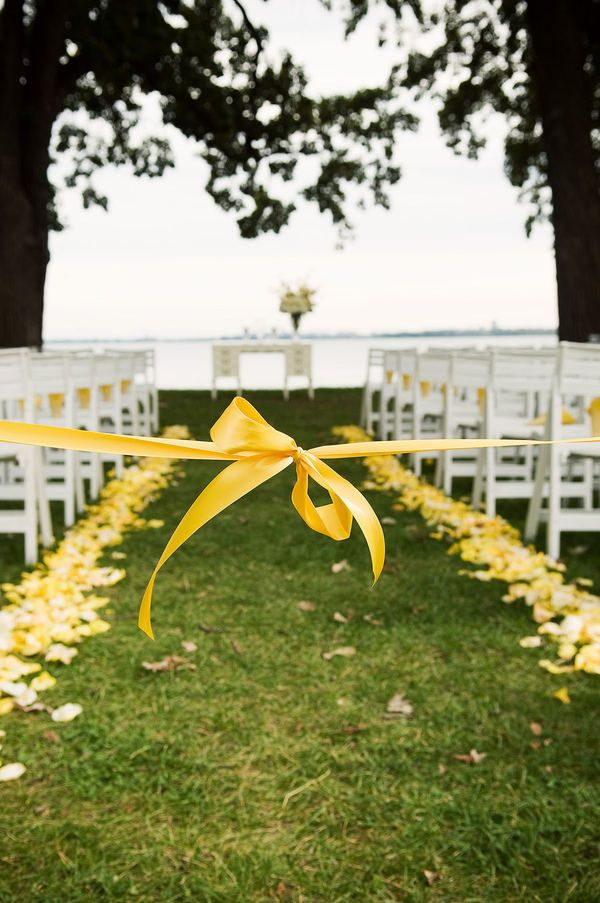 I like the idea of tying off the center aisle so that no one walks down it before the bridal party....