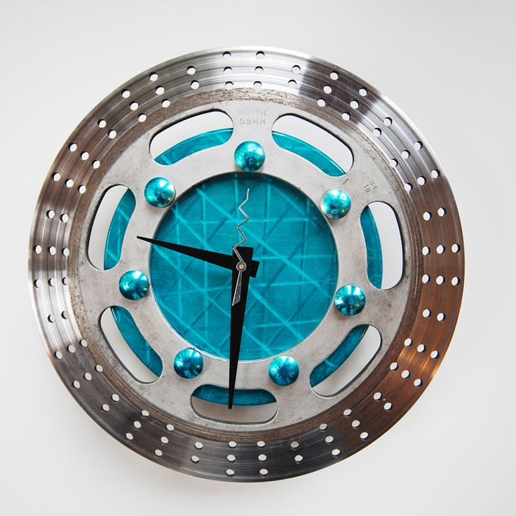 Tic Tac Teal Clock - Made with parts sourced from local vendors in and around Washington state, these fully functional timepieces from reCycle Clocks combine variously shaped and colored sprockets to create eye-catching, ready-to-hang timepieces.