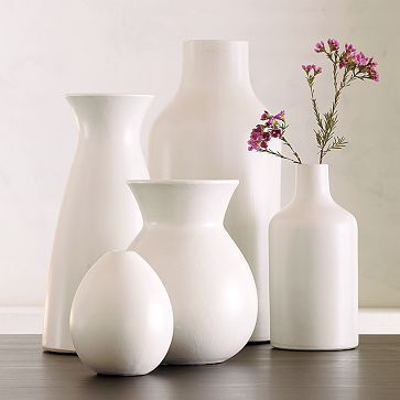 white ceramic vases... I LOVE These simple white vases... Sometimes you want all the intricate details-sometimes you just want simple design!!!