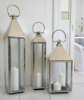 California Style......I love these lanterns.....buy the flameless real wax candles.....put them on the porch....winter & summer.....