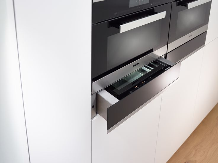 Sleek and unobtrusive, the Miele Generation 6000 EVS 6214 PureLine Vacuum Sealing Drawer looks great when combined as a bank of appliances