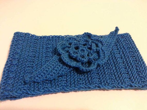 Handmade knitted blue headband with knitted brooch. 50 % wool. For girl or woman