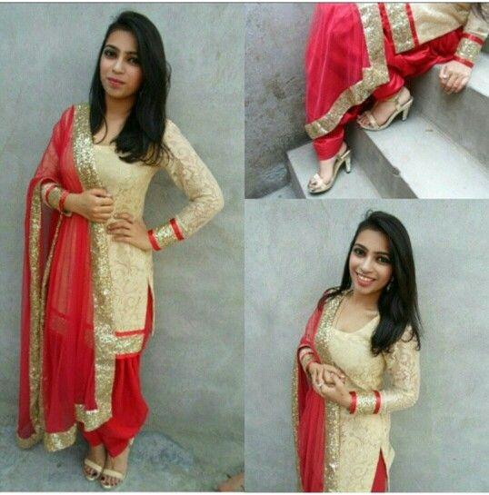 Red and Gold Punjabi Suit made at @nivetas design studio whatsapp +917696747289 www,facebook.com/punjabisboutique