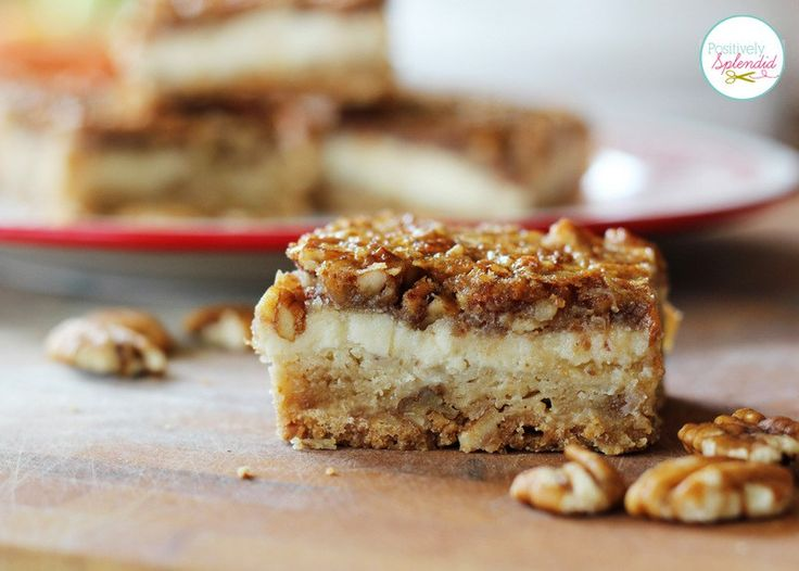 Pecan Cheesecake Squares Recipe at Positively Splendid - A layer of shortbread, a layer of cheesecake, and a layer of pecan pie in every bite. YUM!